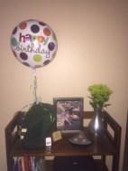 Keem brought flowers and a balloon to keep it festive.
